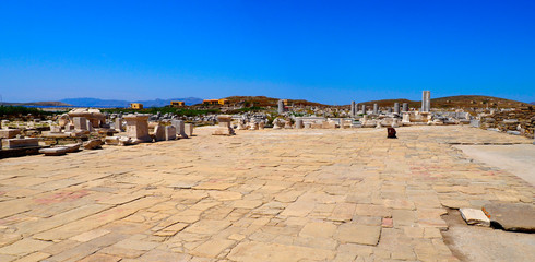 Superb panoramic view of the agora of the archaeological city of Delos island, near Mykonos, beautiful Cycladic island, in the heart of the Aegean Sea