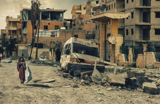 Homeless little girl walking in destroyed city, military soldiers and helicopters and tanks are still attacking the city