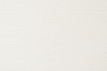 Cotton silk fabric wallpaper texture pattern background in light pastel beige cream color tone
