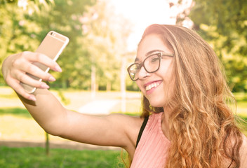 young girl is taking a selfie on a sunny day