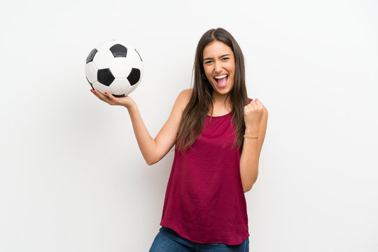 Young woman over isolated white background holding a soccer ball
