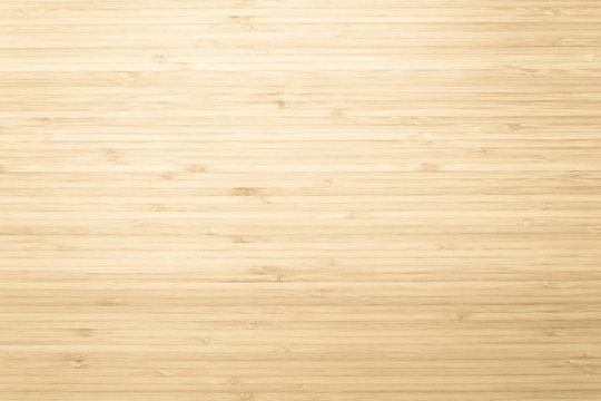Bamboo natural wood texture pattern background in light yellow cream beige brown color
