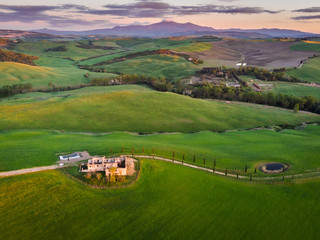 Papiers peints Lavende Aerial drone landscape of famous Tuscany hills, Italy spring fields sunset Asciano Siena Firenze