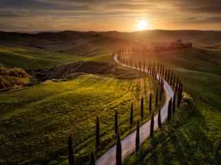 Fotorolgordijn Chocoladebruin Aerial drone landscape of famous Tuscany hills, Italy spring fields sunset Asciano Siena Firenze
