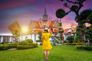 Wall Mural - Woman tourist is sightseeing inside Wat Arun in Bangkok, Thailand.