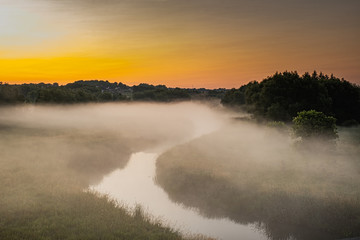 Foto op Canvas Meloen beautiful morning at Rogers Reservoir Conservation Area East Gwillimbury Ontario Canada with grasses, trees, fog, bridge, and river