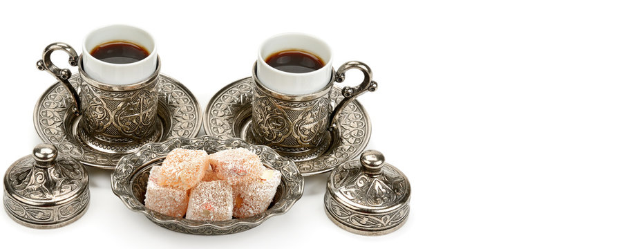 Cups of coffee and turkish delight isolated on white background. Free space for text. Wide photo.