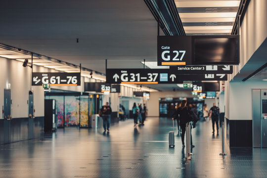 Peoples walking and carries luggage in Vienna airport terminal