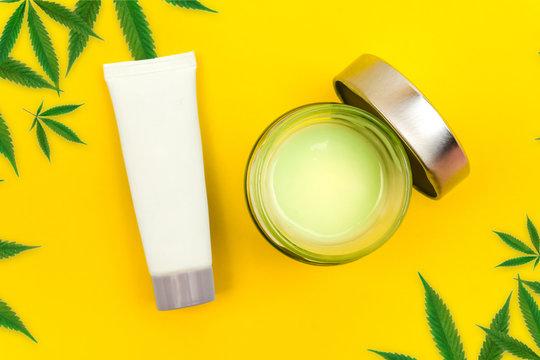 CBD cannabis gel and lotion with cannabis leafs