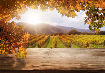 Foto op Aluminium Honing Brown wood table in autumn vineyard landscape with empty copy space on the table for product display mockup. Winery and wine tasting concept.