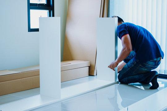 Service man assembling furniture for customer, Delivery service furniture store and assembling for buyer.