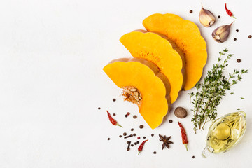Sliced of raw butternut pumpkin with spices and olive oil. Place for text or recipe