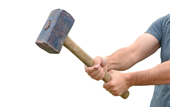 Hit and destroy concept. Strong man's hands with a sledgehammer isolated on white.