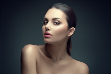 Wall Mural - Sexy beauty brunette woman with perfect makeup. Beauty girl's face on dark background. Skincare