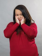 Unhappy sad big woman