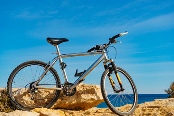 Bicycle on beach, active lifestyle.