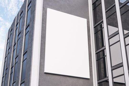 Empty white poster on concrete building