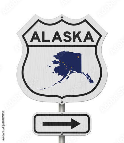Alaska map and state flag on a USA highway road sign\