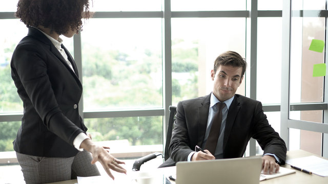 Caucasian man in trouble having problem with his female boss