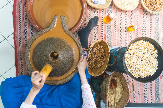 Woman Mashing and Crushing Spices in a Traditional Way.