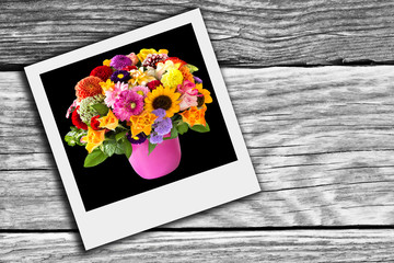 Bouquet of various colorful flowers and wooden background