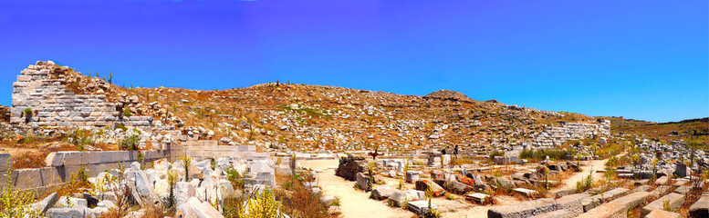 panoramic view of the ancient theater in the archaeological city of Delos Island, near Mykonos, beautiful Cycladic island, in the heart of the Aegean Sea