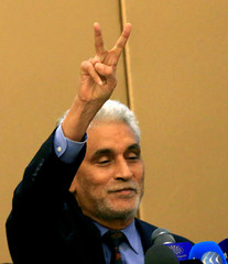 African Union mediator Mohamed El Hacen Lebatt flashes a victory sign as he attends a constitutional declaration  signing ceremony in Khartoum