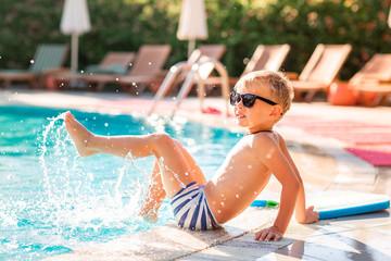 Happy little boy having fun at the pool