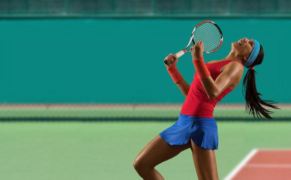 Woman tennis player celebrating winner