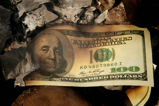 US Dollar bill in fire as a symbol of missed and lost business opportunities