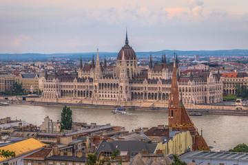 Fototapeten Budapest Budapest - June 21, 2019: Parliament building of Budapest by the Danube river, Budapest, Hungary