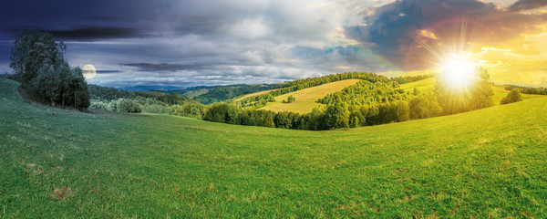 Tuinposter Landschappen panoramic mountain landscape day and night time change concept. grassy meadow on the hillside. trees on the edge of a hill. mountain ridge in the distance. sun and moon on the sky