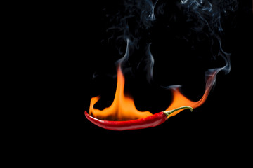 Red chili with a flame on a black background, the concept of spicy