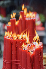Amazing closeup view of burning red ritual candles