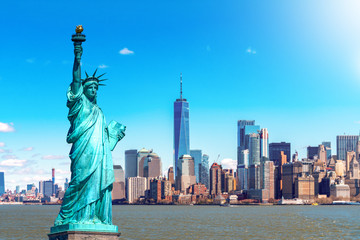 Fototapete - The Statue of Liberty with the One world Trade building center over hudson river and New York cityscape background, Landmarks of lower manhattan New York city. Architecture and building concept