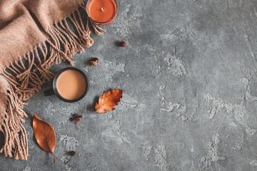 Autumn composition. Cup of coffee, plaid, autumn leaves on black background. Flat lay, top view, copy space