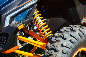 Atv off road bike front wheel tire, head light, suspersion part detail close up