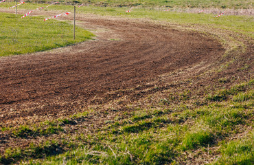 Turn of atv race track. Dust and grass