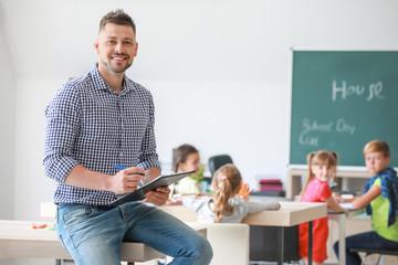 Portrait of male teacher in classroom