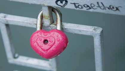 Pink heart shaped love padlock - beautiful wedding day custom.
