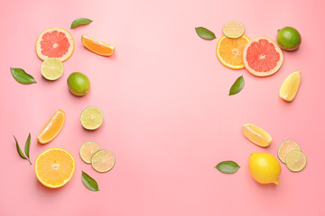 Different sliced citrus fruits on color background Wall mural
