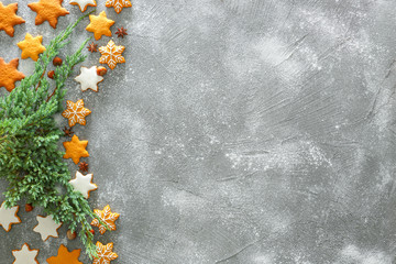 Composition with tasty Christmas cookies on grunge background