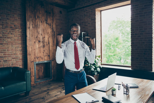 Photo of dark skin guy got investment for startup wear elegant costume standing up from office chair