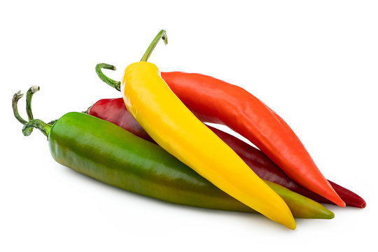 Pile of mixed red, yellow, orange and green cayenne chillies isolated on white.