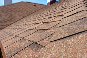 Asphalt tile roof on new home under construction