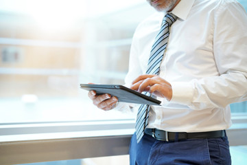 Businessman working on tablet in contemporary office building