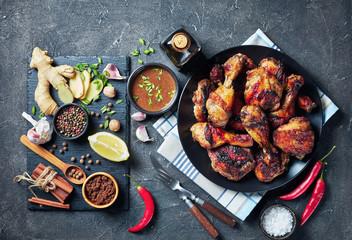 Grilled spicy Jerk Chicken drumsticks and thighs