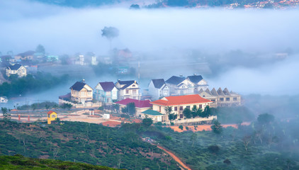 The city sinks in a beautiful morning mist to welcome the new day tropical highlands in Da Lat, Vietnam