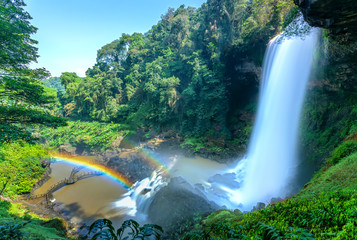 The majestic Dambri Falls near Bao Loc City, Vietnam. The waterfall is over 90m high, pouring into the valley, creating fog and rainbow when the sunshine through