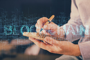 Man's hands working with notes background. Cryptocurrency and finance concept.
